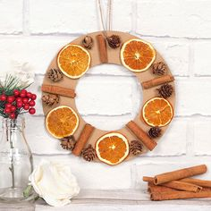 Scented Wreath | Free Craft Ideas | Baker Ross This wreath will smell just like Christmas, with a mix of orange, cinnamon and pine cones.
