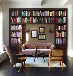 Damon Liss carved this cozy, intimate library nook out of a larger, loft-like space in Tribeca, New York City. The light-filled corner includes armchairs by Kerstin Horlin Holmquist and Pierre Jeanneret, as well as a Martin Eisler coffee table purchased from Espasso.