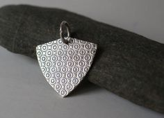 Crest pendant, geometric guitar plectrum jewelry in sterling silver