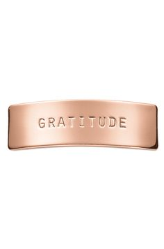 "Saying ""thank you"" isn't just good manners, it's the key to feeling blessed. Wear the Gratitude Key as a reminder to give thanks for all things."