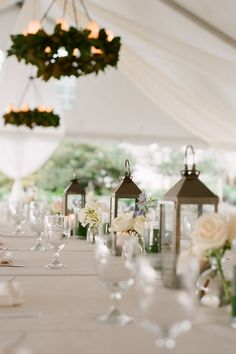 love the inside of the tent and table centerpieces (but modify for round tables)
