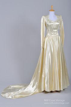 Wow! Mint condition and a do-able size for most! Love. Designed in the 40's, this amazing formal vintage wedding gown is done in a creamy silk satin with hand beading. The bodice features a square neckline with c...