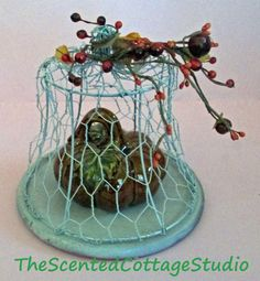 Tut for an adorable chicken wire and lamp shade frame cloche by Francie at The Scented Cottage