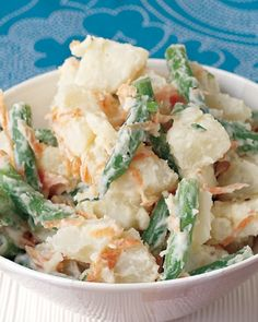 Warm Potato-Veggie Salad - Simmer baking potatoes and green beans in the same pot to start this warm potato salad. Add sliced scallions and grated carrot, then toss with an easy dressing made from light mayonnaise and white-wine vinegar.