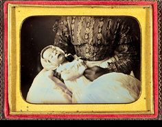 ca. 1840-50s. A dramatically lit horizontal postmortem image of a tiny baby placed upon the aproned lap of a black woman, only her hands visible to signify her race. A superb, and cerebral image, that speaks volumes of the complex interrelationships between slaves and masters in the Antebellum south.