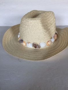 A personal favorite from my Etsy shop https://www.etsy.com/listing/279890354/summer-straw-floppy-hat-summer-sea-shell