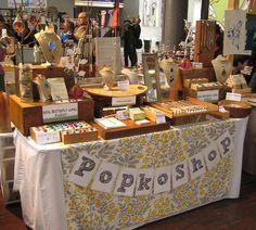 I like the table cloth!  craft show table