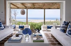 High on the mountainside overlooking Plettenberg Bay lagoon, Indigo House commands a spectacular view and boasts signature indigo, white and wood interiors. Outdoor Spaces, Outdoor Living, Outdoor Decor, Outdoor Seating, Miami Beach House, Luz Natural, Wood Interiors, Palette, Coastal Homes