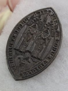 "A 14th century Bishop's seal discovered by metal detector enthusiasts will go on display at the Manx Museum. The silver seal, which was discovered by Andy Falconer, is described as ""incredibly significant"". The seal itself is about three centimetres in length, made of silver, and shows two figures sitting facing out and a third kneeling in prayer. Around the edge there is an inscription in Latin, which translates as ""Let the prayers to God of Germanus and Patricius help us""."