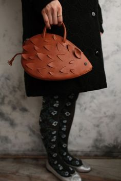 black and white flower pattern tights and silver shoes; hedgehog handbag