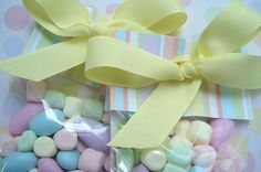 Candy favors: clear bag with a pretty scrapbook paper at the top and ribbon