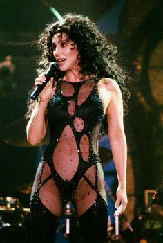 Turn Back Time  Cher in a 1992 performance, a direct sartorial reference to a showpiece from her 1979 show (with an assist from sheer nylon). If she could turn back time? Not if, but rather … how.     By Peter Stil/Redferns.