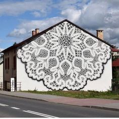 Street Art NeSpoon, Lace Graffiti _ga- I like it, kind of like the yarn bombing. I think it could be done with rope although it'd be more expensive... maybe. That would be some sturdy tatting. hahaha