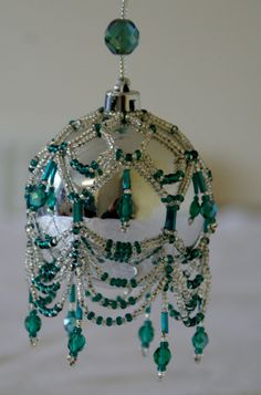 Hand Beaded Swags and Tails Christmas Bauble.(not available) - note: various ideas for swags and drops Beaded Christmas Ornaments, Handmade Christmas, Christmas Crafts, Xmas Baubles, Green Christmas, Christmas Trees, Swags And Tails, Beaded Ornament Covers, Beading Patterns Free