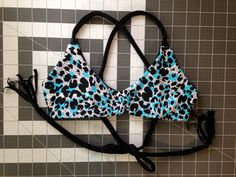 A personal favorite from my Etsy shop https://www.etsy.com/listing/215011635/reversible-cross-back-bikini-top-with