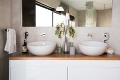 Grey, white and timber bathroom with free standing bath. Timeless bathroom design. See more >>>
