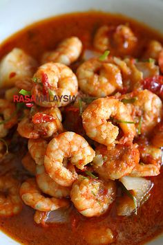Sambal Udang (Prawn Sambal) recipe - This version is my family's sambal udang recipe, passed down from my  mother. She would always add some thinly sliced kaffir lime leaves to perfume the dish with its aroma. Every bite is bursting with the briny flavor of the prawn, follows by the complex flavor of the sambal, and ends with a citrusy note of the kaffir lime leaves. #malaysian #shrimp