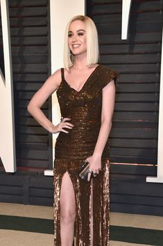 Katy Perry wore a Jean Paul Gaultier Spring 2017 Haute Couture bronze embellished dress & Jimmy Choo accessories to the 2017 Vanity Fair Oscar Party. | Attends the 2017 Vanity Fair Oscar Party hosted by Graydon Carter at Wallis Annenberg Center for the Performing Arts on February 26, 2017 in Beverly Hills, California.
