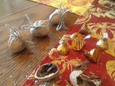 For My Thanksgiving table this year...hollowed out walnuts filled with Hershey Kisses tied with twine