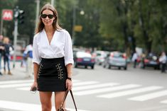 How To Dress Like An Italian Girl — 50+ Lessons Worth Knowing #refinery29  http://www.refinery29.com/2014/09/74945/milan-fashion-week-2014-street-style#slide-74  A robe-wrapped poplin shirt and a rope-stitched skirt.