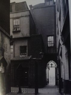 Rear elevation of the Gatehouse to St Bartholomews the Great 1908. The entrance passage to the church