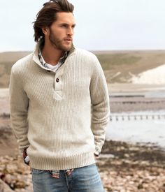 Nice man by the water in a loose casual sweater, jeans and that hair...