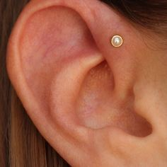 Adorable healing single forward helix showing off a cute genuine pearl from…