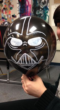 Death Star balloon for use with pool noodle lightsaber game.