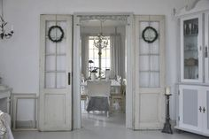 Reuse current fam room doors in current bathroom or use in dining room. Line panes w mirrors or sheet music and lean against walls.