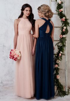 A long tulle gown with a charming high neck that clasps in the back with hook and eye, forming a keyhole back between the clasps and the top of the zipper; complete with a stylish ruched and pleated bodice. Tulle available in all tulle colors.