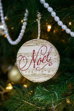 DIY Stamped Ornament with Noel - uses a wood slice and glitter glue to make a beautiful ornament decoration.