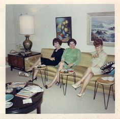 The Fashionable Lady and Friends on a Golden Couch, each with their own ashtray table. That's class!