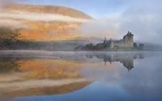 A misty morning beside Loch Awe with views to Kilchurn Castle, Argyll & Bute, Scotland.  Picture: Adam Burton / Rex Features.