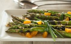 An elegant yet simple way to dress up asparagus. Grilled spears are tied together with chives and topped with a flavorful orange vinaigrette.