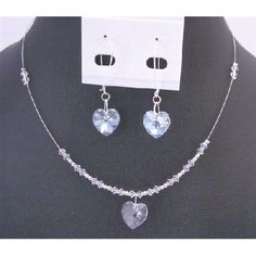 Clear Crystals Heart Pendant Earring Set Dainty Valentine Heart Gift  Price $22.99  fashionjewelryforeveryone.com/CrystalsStatic/NSC704.html  Material Used : Swarovski Clear 4mm Bicone Crystals 14mm Heart Crystals Pendant Sling Rhodium Wire Necklace  Necklace Length : 16 inches with 2 inches extension  Earrings : Swarovski Clear Heart Pendant Crystals 14mm accented in Genuine Sterling Silver HooP measures 2 inches long