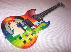 "Clapton's '64 Gibson SG Standard, painted by two Dutch artists known as ""The Fool."""