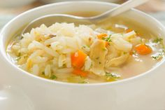Slow Cooker Cream of Chicken and Rice Soup - filled to the brim with tender bites of chicken, carrots, potatoes, celery, & onion.  #slowcooker #chickenricesoup #souprecipes