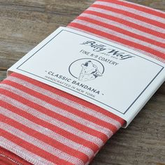Handmade in Brooklyn, NY, this traditional square bandana is cut from red and cream striped linen and sewn with cream stitching.