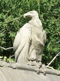 Vulture on The Animal Wall, Cardiff Castle, Wales by Alexander Carrick (1882-1966) 1931. The Animal Wall borders Bute Park on the approach to Cardiff Castle.