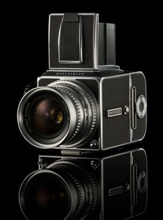"""The Hasselblad 500 C/M. Lens options: Carl Zeiss 150mm Sonnar, 80mm Planar & 50mm Distagon.  Buy a chrome one from David Odess (very reputable seller). Get a """"clean lube adjustment"""" from him, also. Buy an NPC POLAROID back or an A12 back, which provides 12 exposures on 120 film. Get a light meter, such as a Sekonic or Gossen Digisix. Ask for a gliding mirror system."""