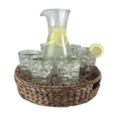 Perfect for Sunday brunch or an alfresco soiree, this lovely beverage set brings a charming touch to your table. Featuring sleek glasses and a pitcher nestle...