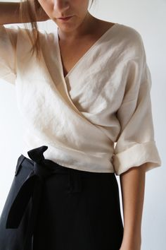 Cream wrap top & black skirt | @styleminimalism More
