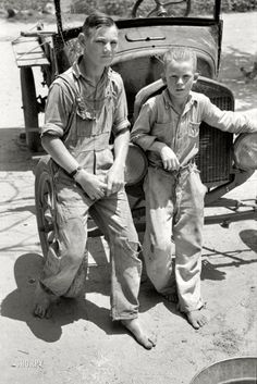"""June 1939. Muskogee County, Oklahoma. """"Near Webbers Falls. Sons of agricultural day laborer after washing up for dinner."""""""