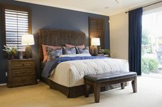 Bedroom with blue accent wall.