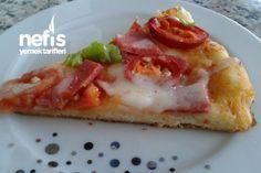 Tavada 10 Dakikada Pizza Tarifi nasıl yapılır? 702 kişinin defterindeki bu tarifin resimli anlatımı ve deneyenlerin fotoğrafları burada. Yazar: Mehtap Turan