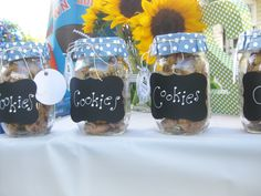 Adorable party favors! Mason jars filled with your child's favorite treat, topped with paper and tied with twine.
