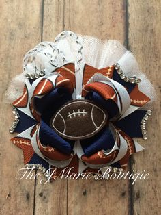 A personal favorite from my Etsy shop https://www.etsy.com/listing/242153301/football-hair-bow-nfl-team-football