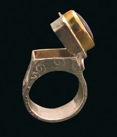 "Embossed ""poison"" ring with a hidden compartment. sterling silver, 22k gold, Koroit opal. 1-1/4"" high x 3/4"" wide x 1/4"" deep, size 6-1/2.  Lucrezia (open) by Victoria Lansford. Lucrezia © 2008, V. Lansford"