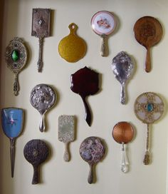 #countryliving #dreambedroom,A collection of vintage hand mirrors displayed on the wall next to the vanity.