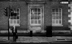 London businessman waiting to cross the street : streetphotography